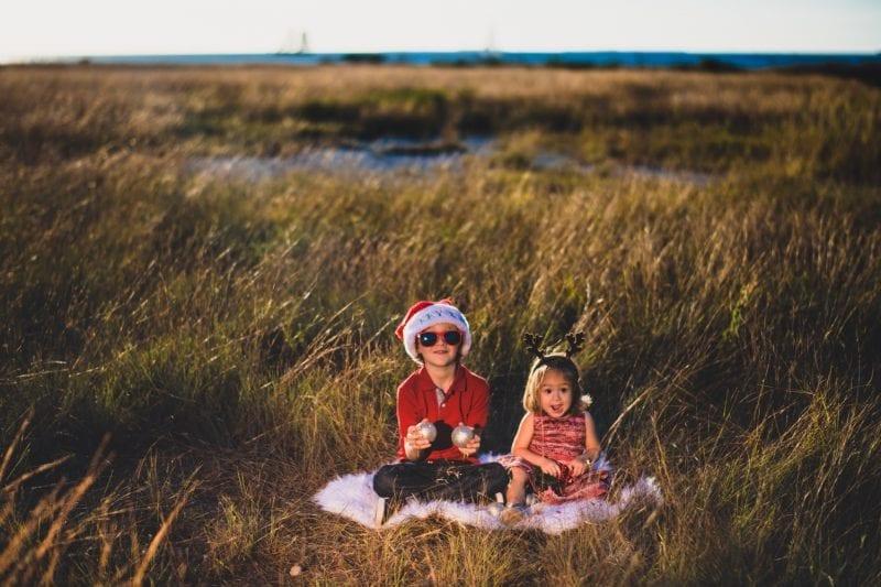 Family portrait of 2 children in high grass in the Florida Keys