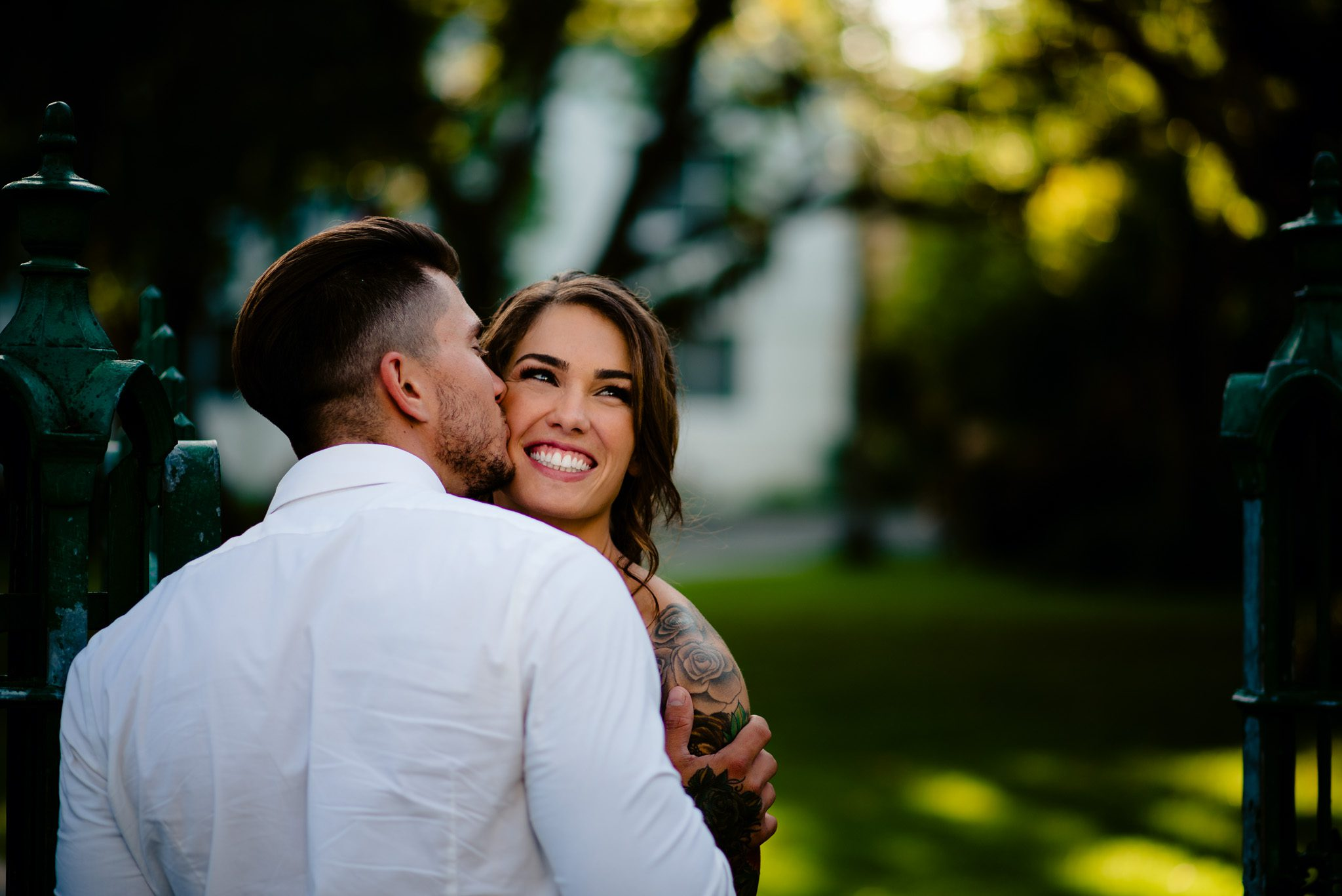 Newly engaged couple kissing during a photoshoot