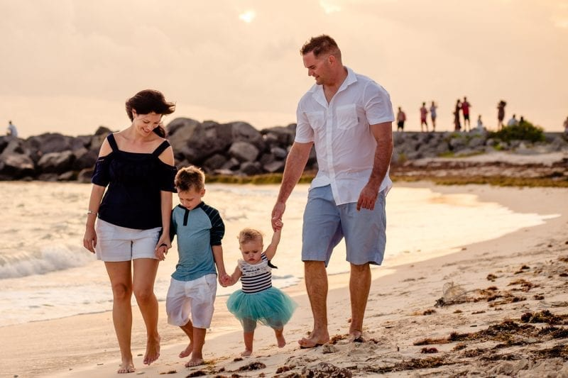 key west family photo of a couple with their 2 young children on the beach