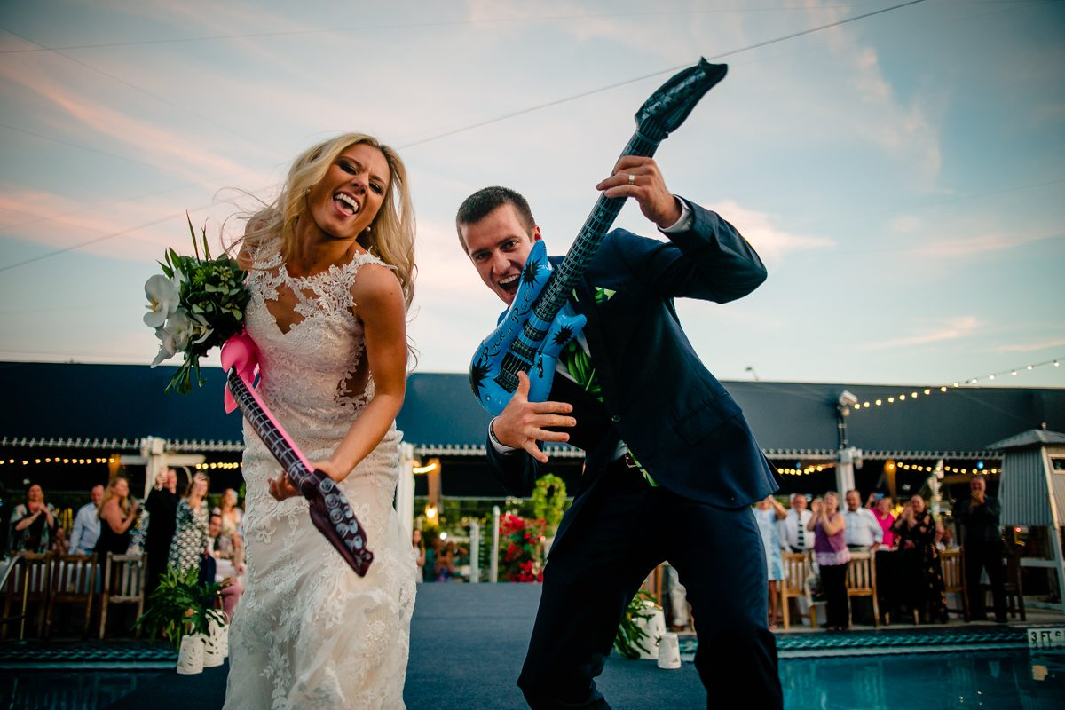 Bride And Groom Play Guitar During Wedding Reception