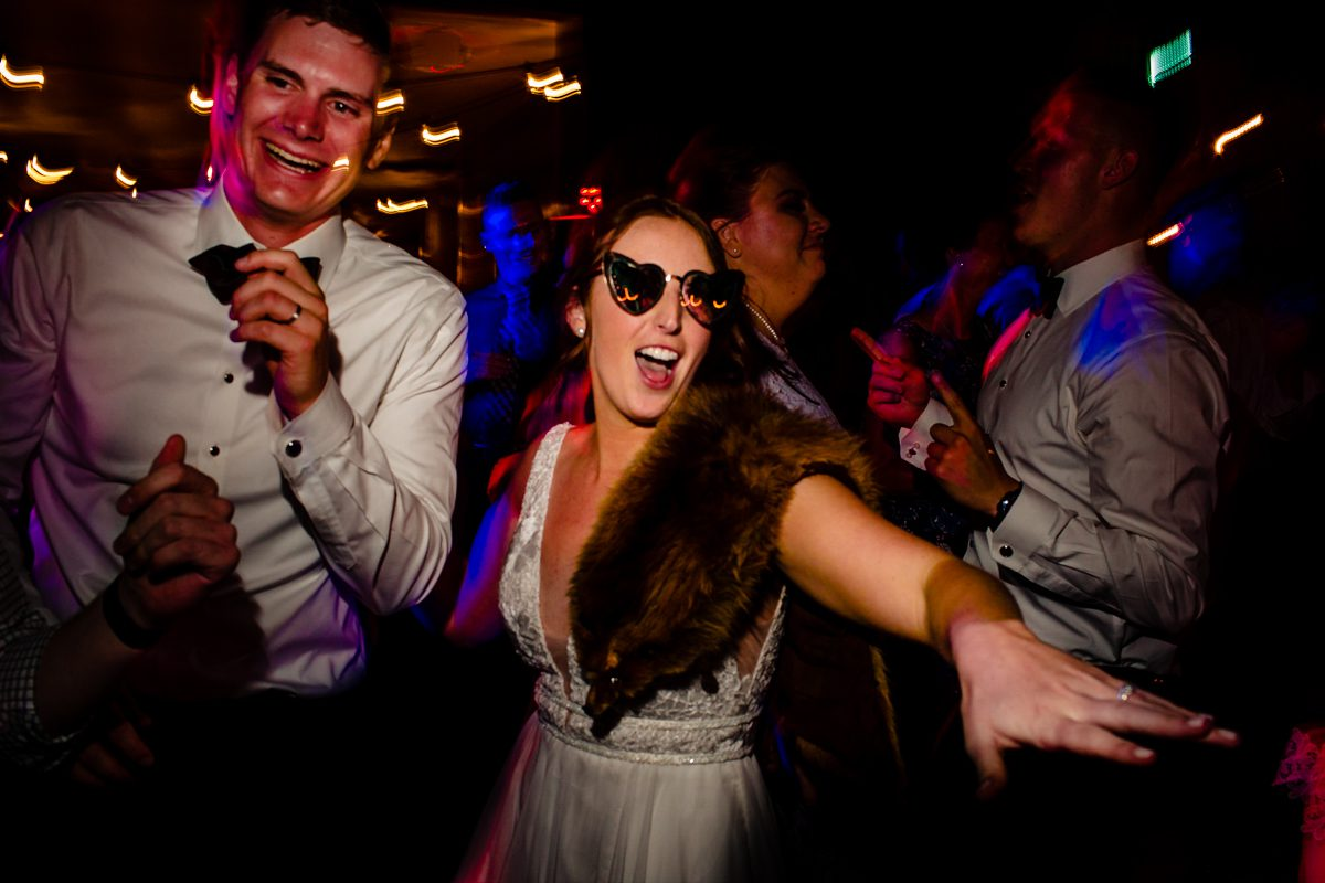 Bride celebrating and dancing during wedding reception in Denver, Colorado.