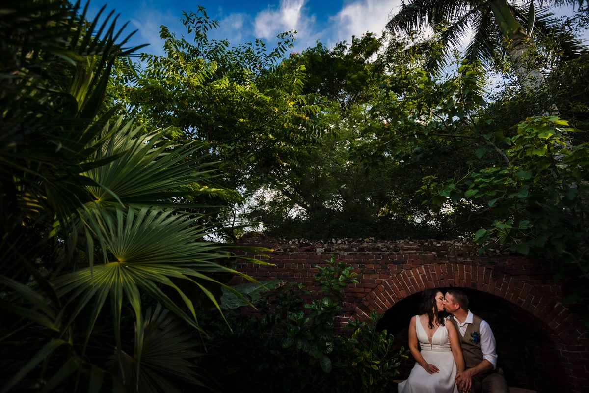 Newly wed couple kiss at Key West, Garden Club.