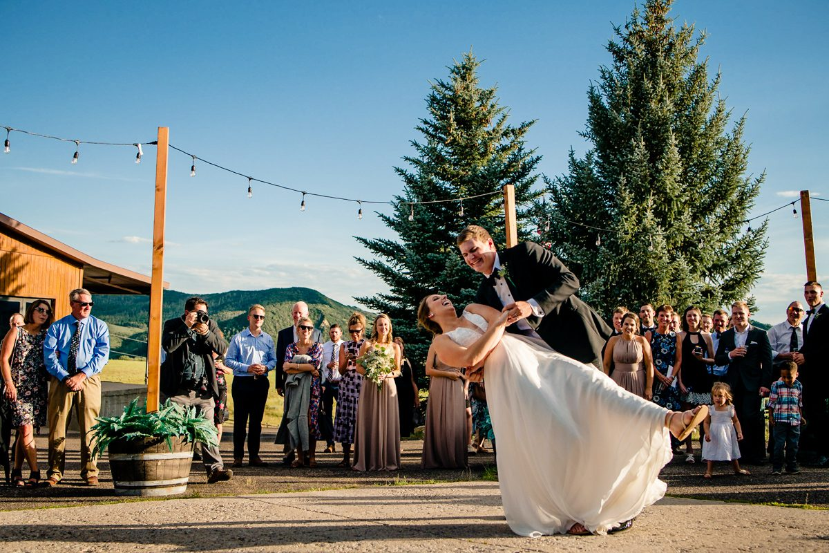 Groom Dances With Bride In Steamboat Springs, Colorado On A Sunny Dance