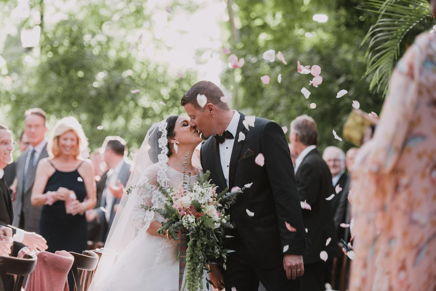 Wedding Couple Kiss During Ceremony by Michael Freas Photography