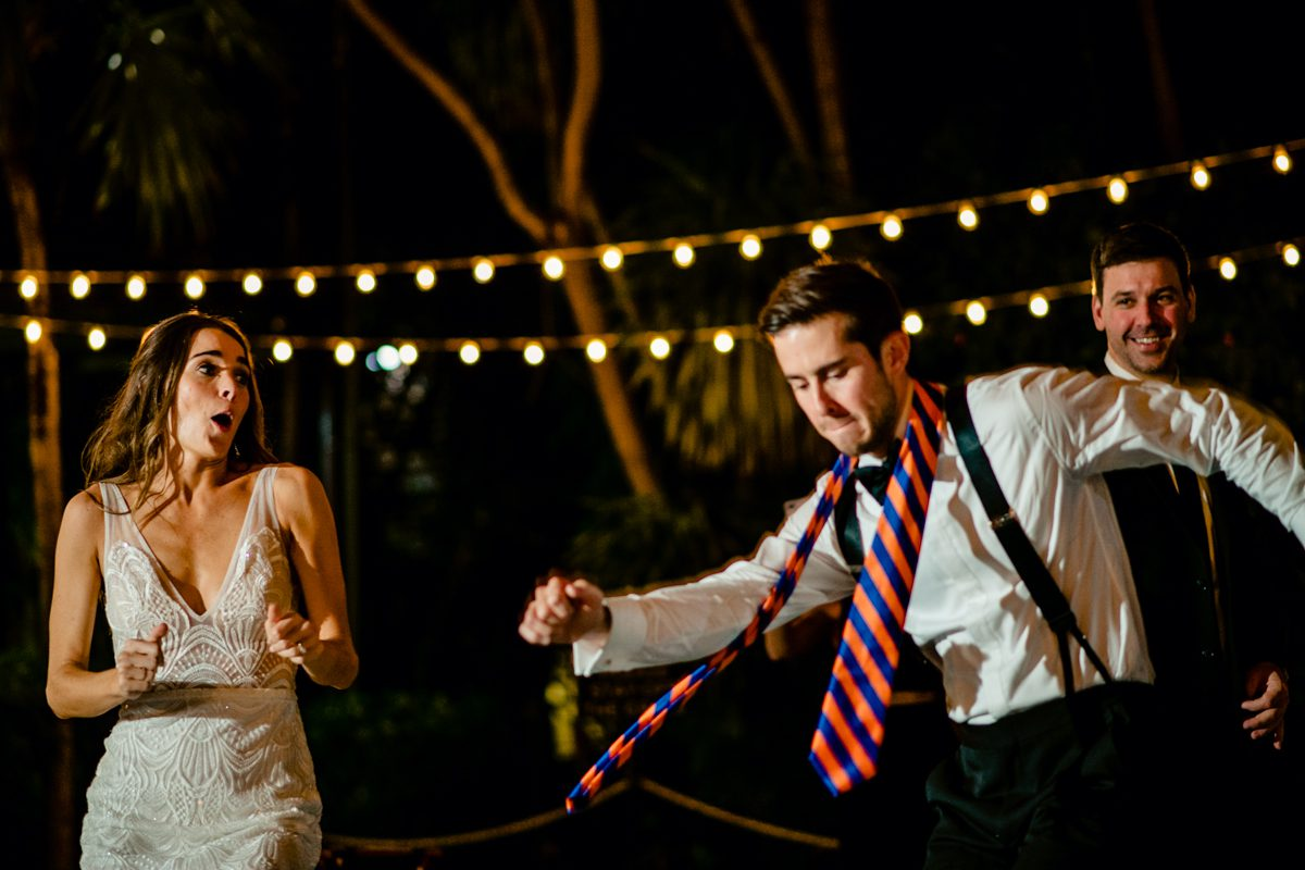 Groom dances at Hemingway Home in Key West, Florida.