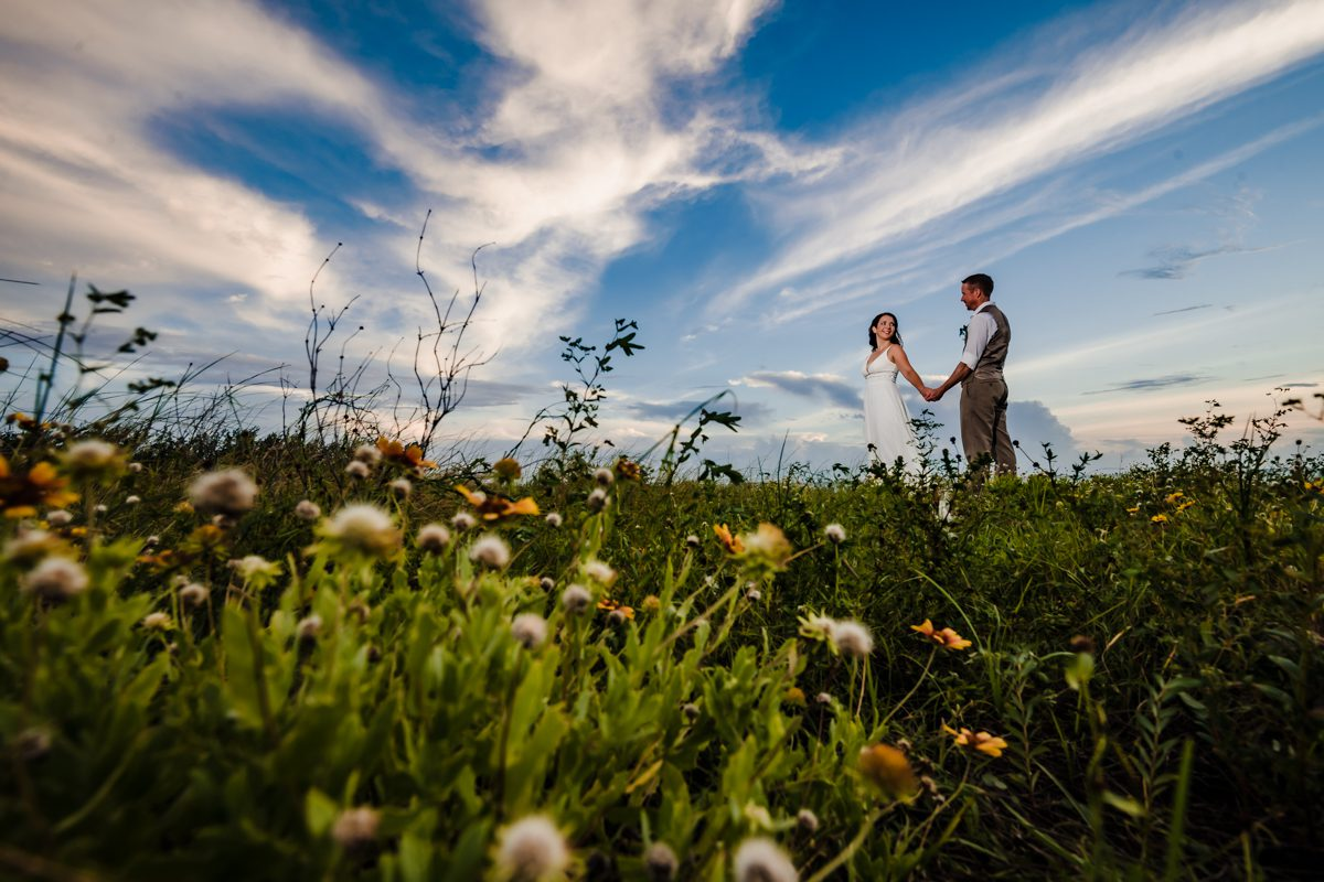 Couple Walk In A Field Of Flowers in Zachary Taylor Key West