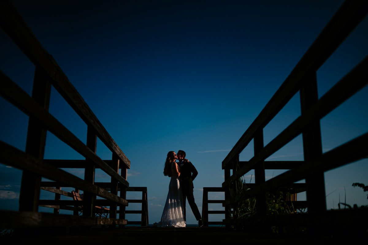 Couple Kiss At Beach Dock in Hemingway House In Key West, Florida