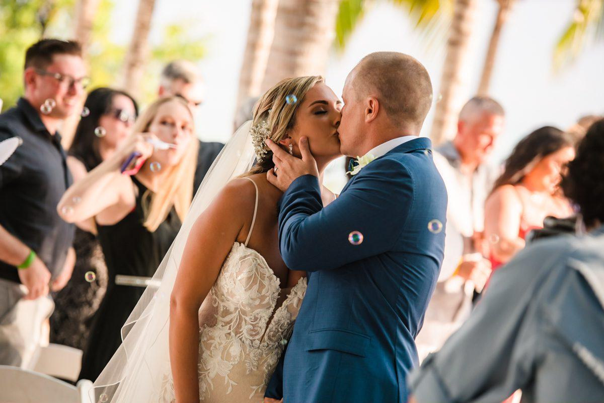 Groom Kisses Bride On Forehead At Isla Bella Beach Resort in Marathon, Florida