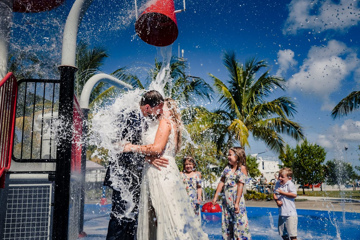 Couple Playfully Celebrate Elopement Under Outdoor Shower In Key West, Florida