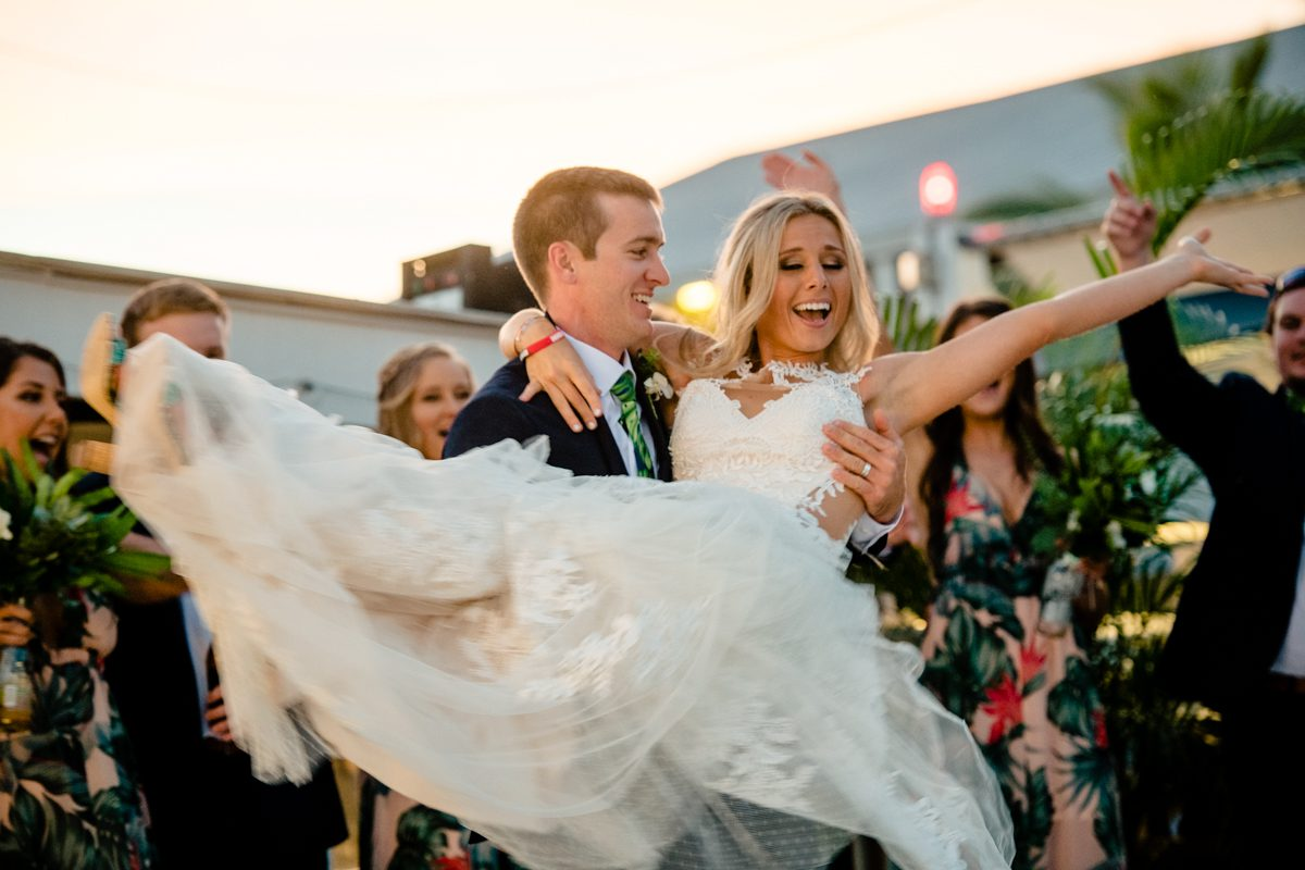 Groom Holds Bring During Wedding Celebration In Islamorada, Florida