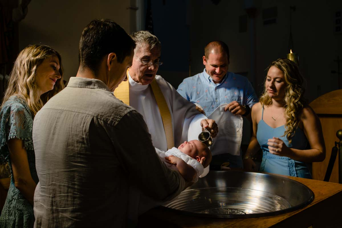 Priest baptizing a baby in Asheville