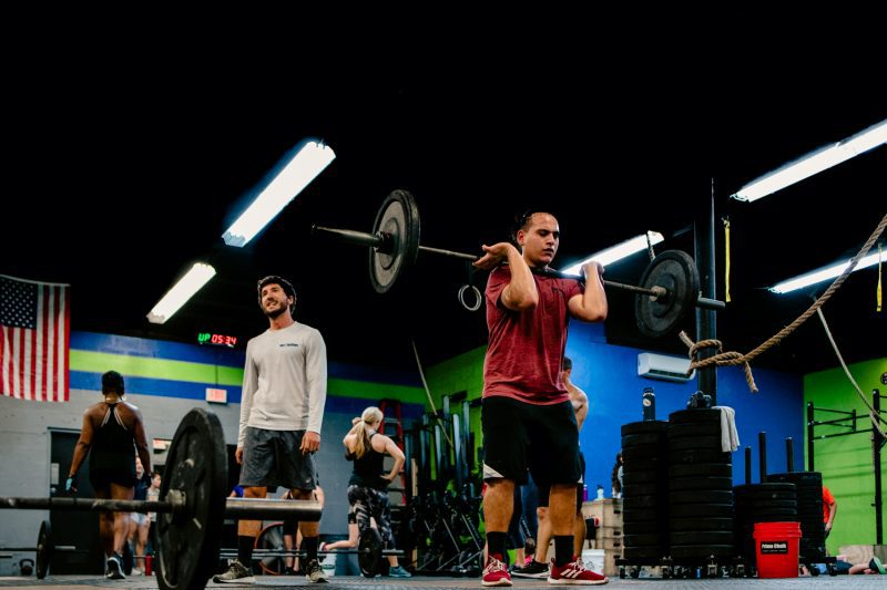 A man weightlifting at a crossfit gym for a commercial photography photoshoot