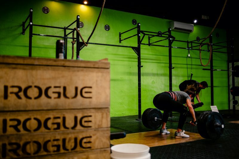 Woman doing a deadlift at a crossfit gym during a commercial photoshoot