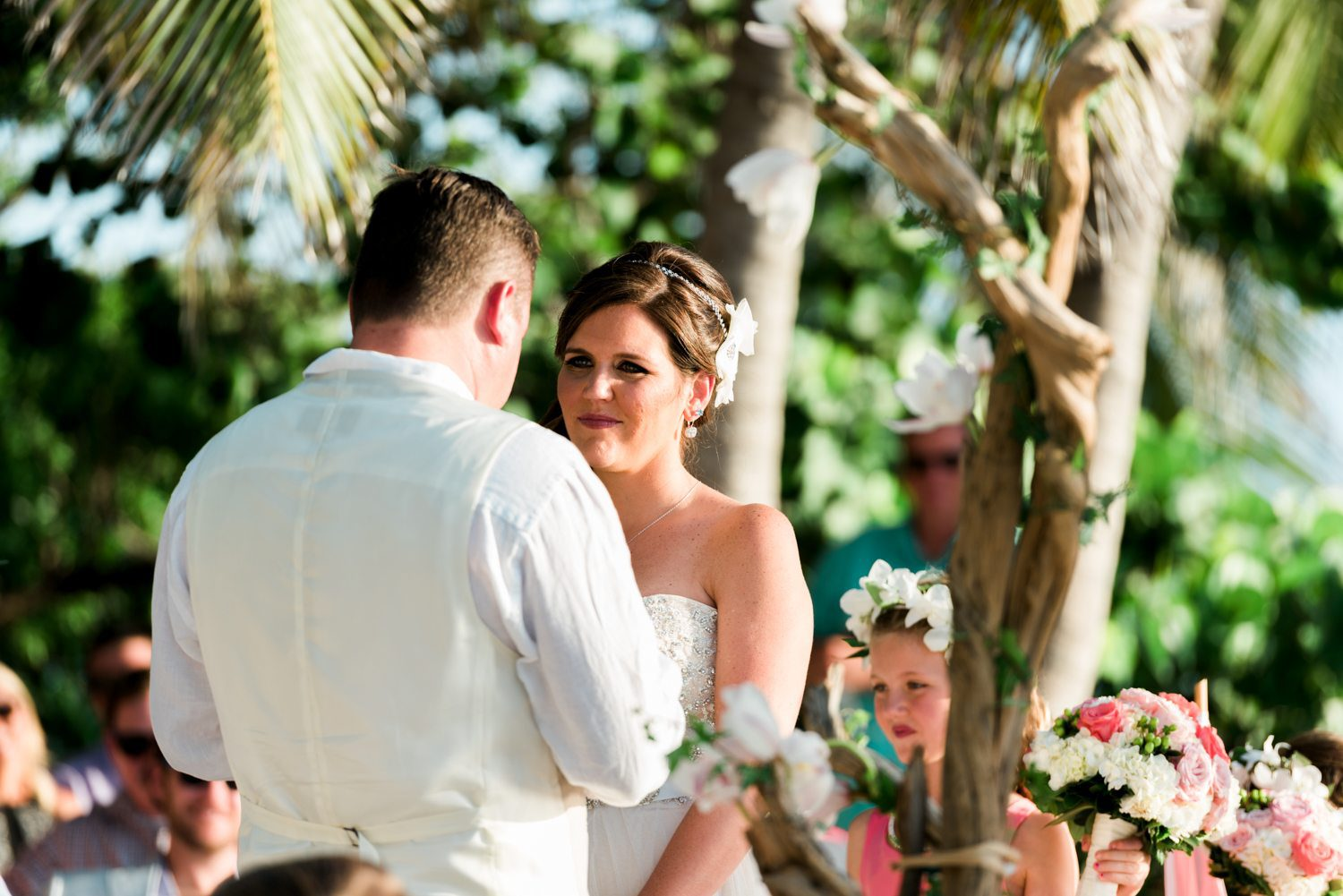 bride and groom exchanging wedding vows at fort zachary taylor