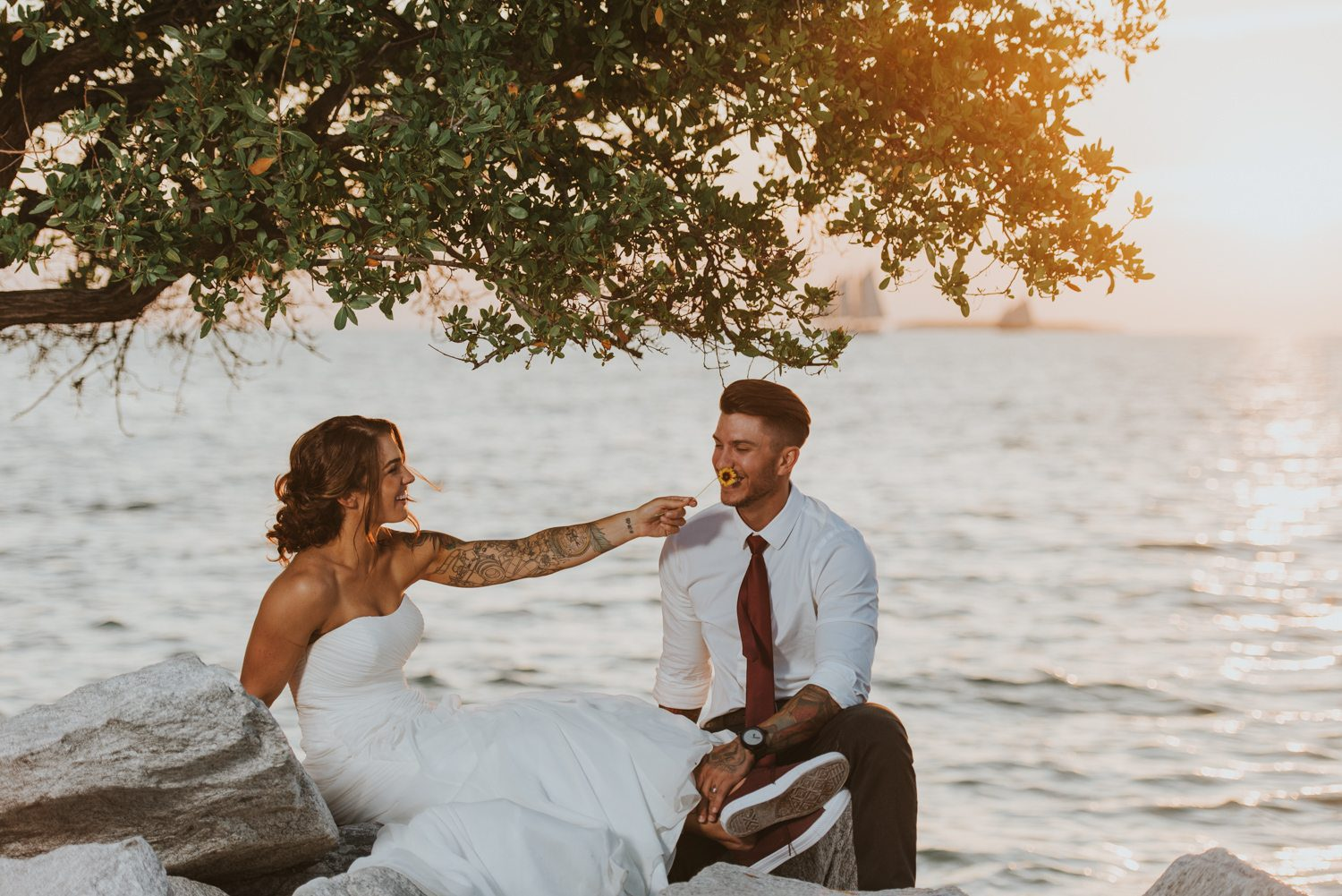 bride and groom taking portraits at fort zachary taylor