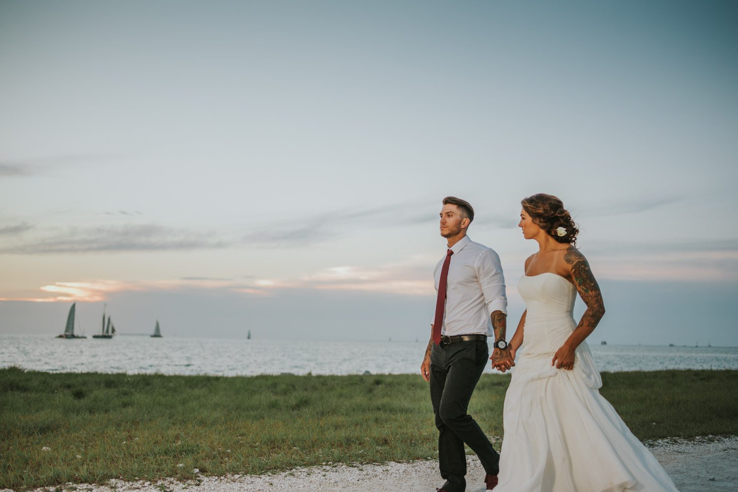 bride and grood walking down the aisle at fort zachary taylor