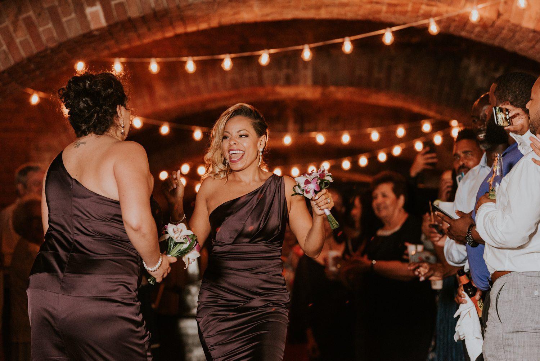 bridesmaids entering wedding reception at fort zachary taylor