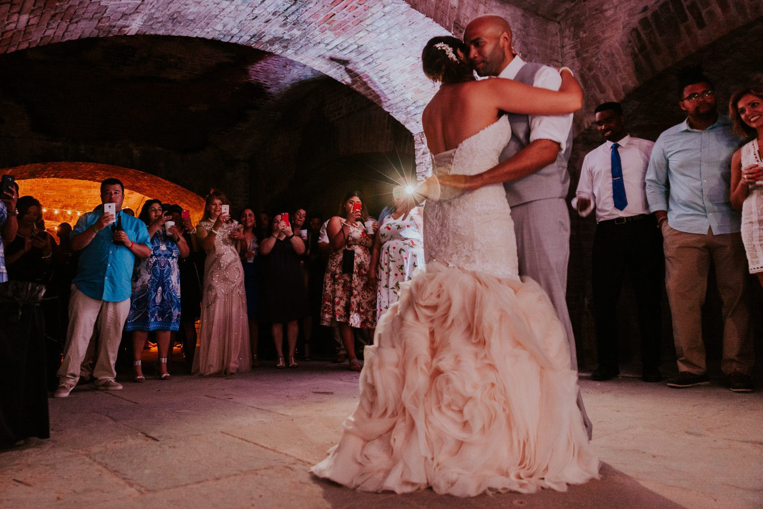husband and wife having their first dance wedding reception at fort zachary taylor