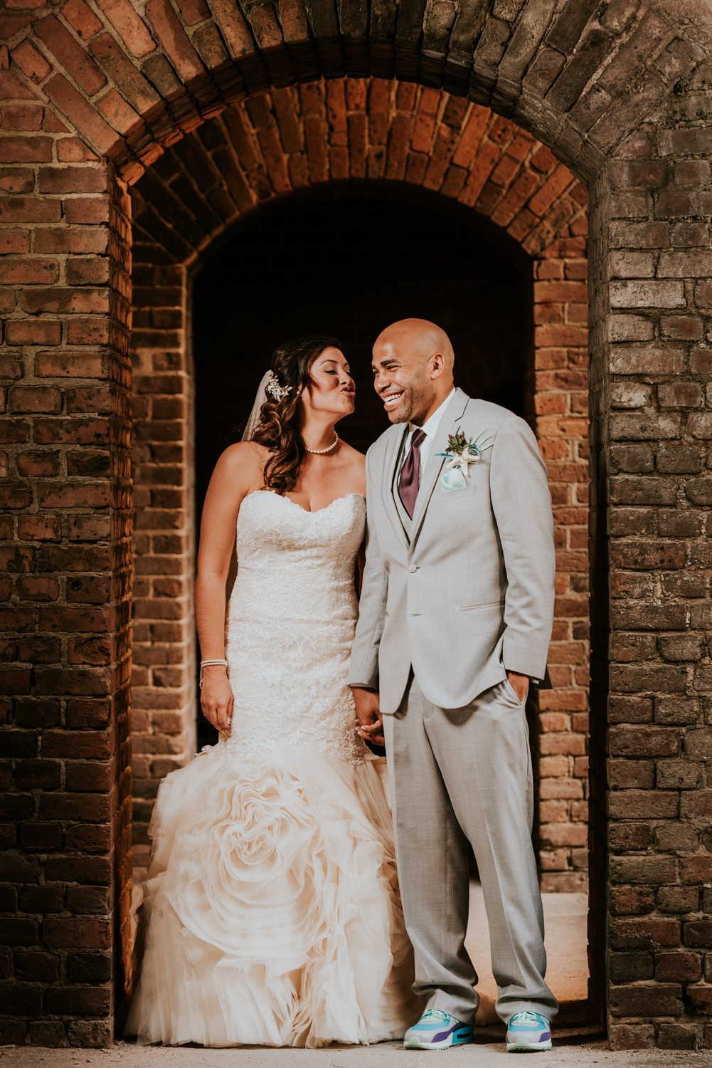 husband and wife entering ceremony at fort zachary taylor