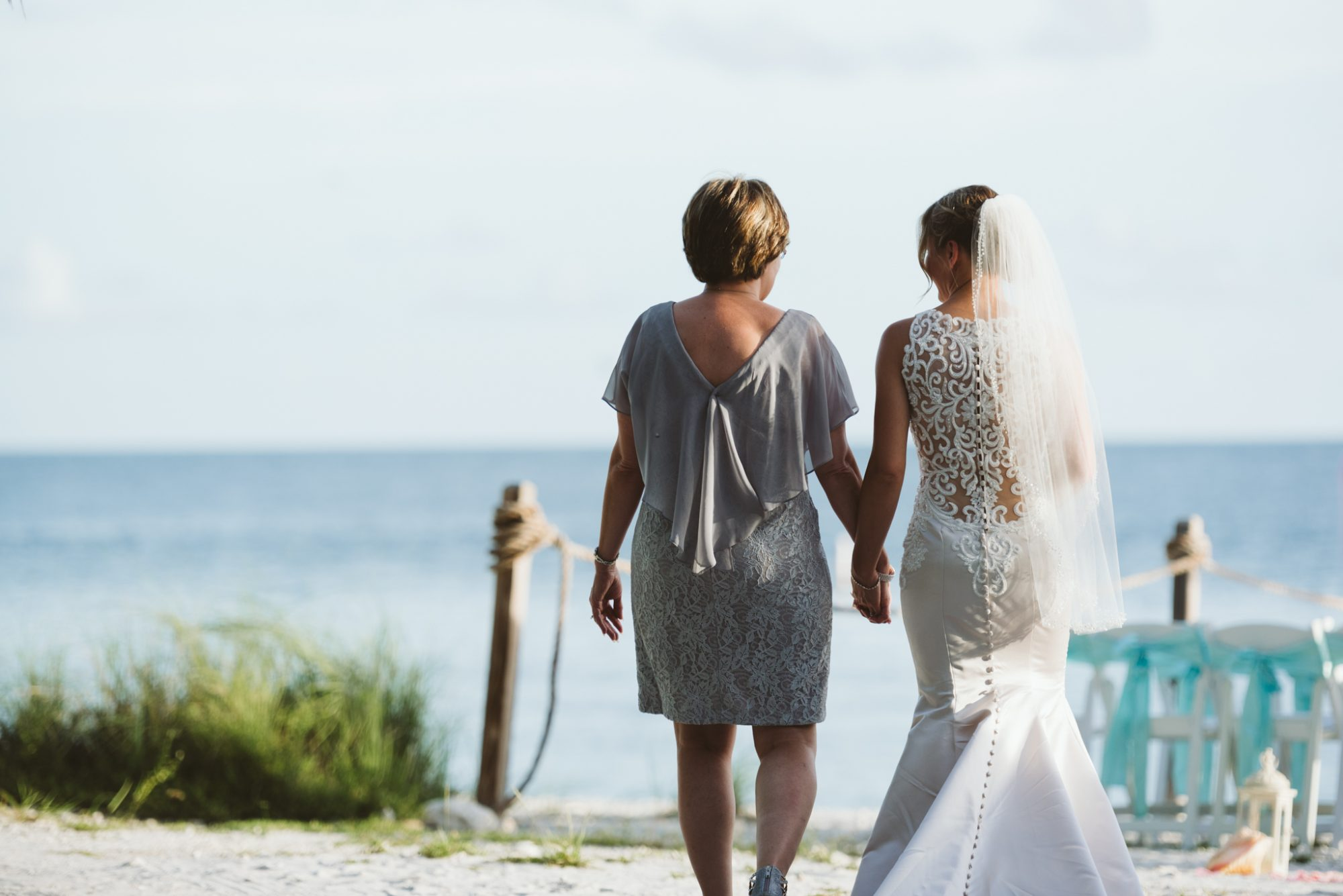 bride walking down the aisle of her wedding at fort zachary taylor