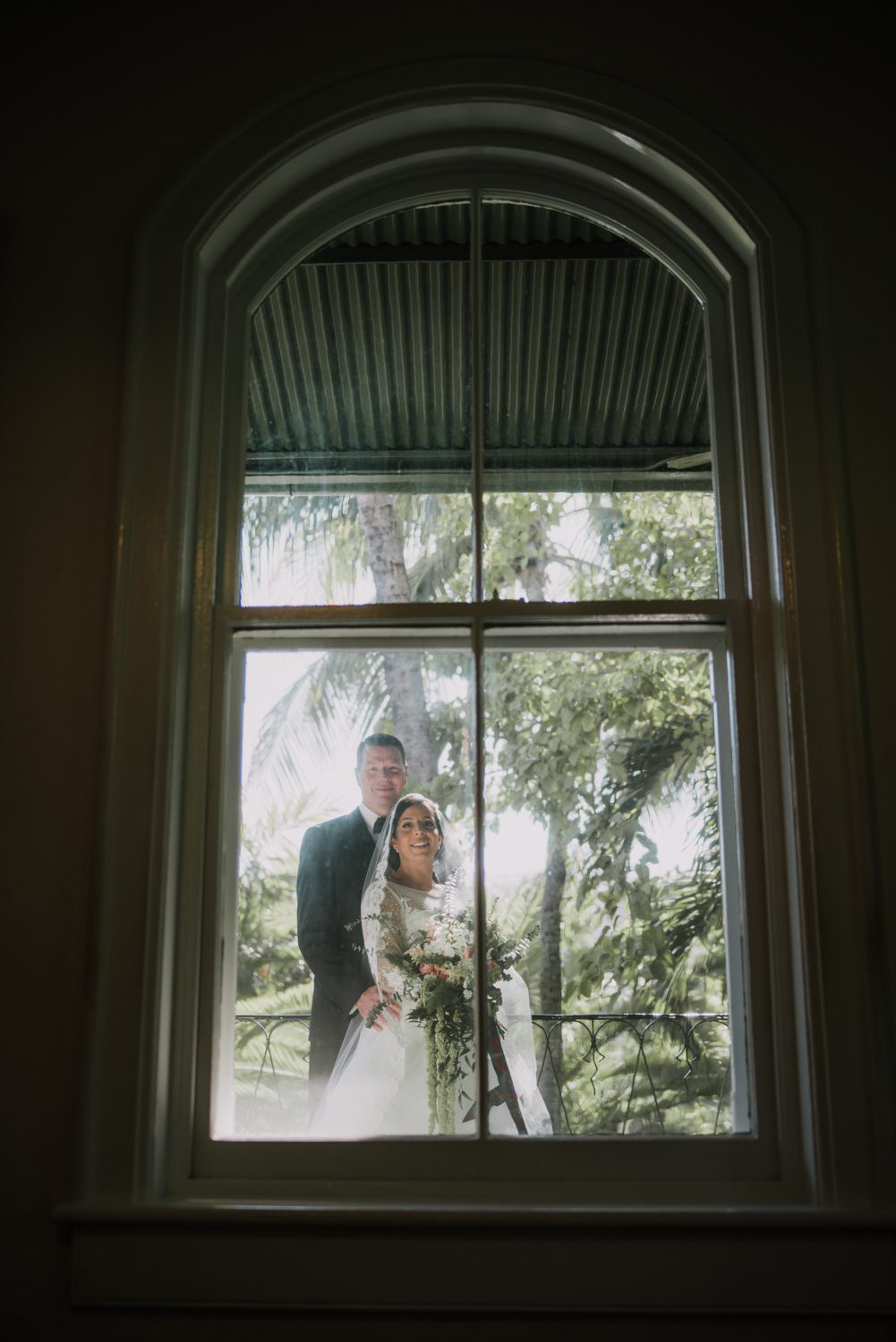 Bride and groom posing for a wedding portrait