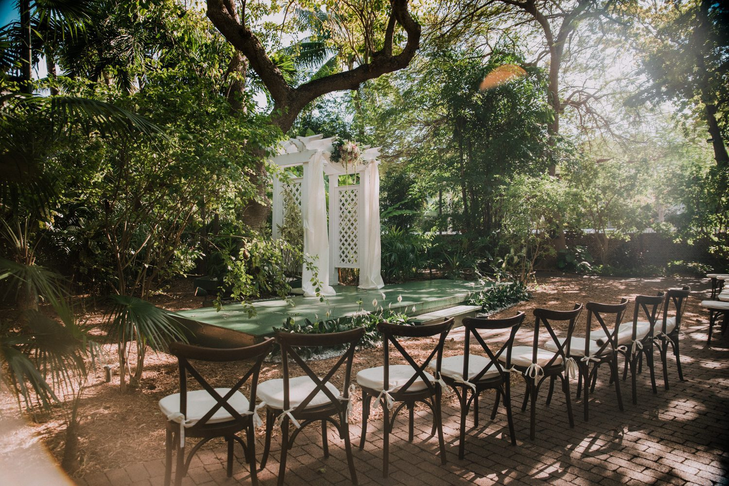 Hemingway house courtyard set up with chairs for a wedding ceremony