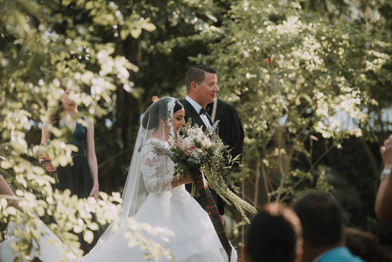 Bride and groom walking down the aisle at hemingway house in key west
