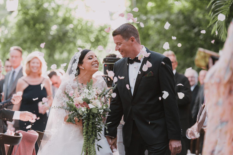 bride and groom walking down the aisle at hemingway house