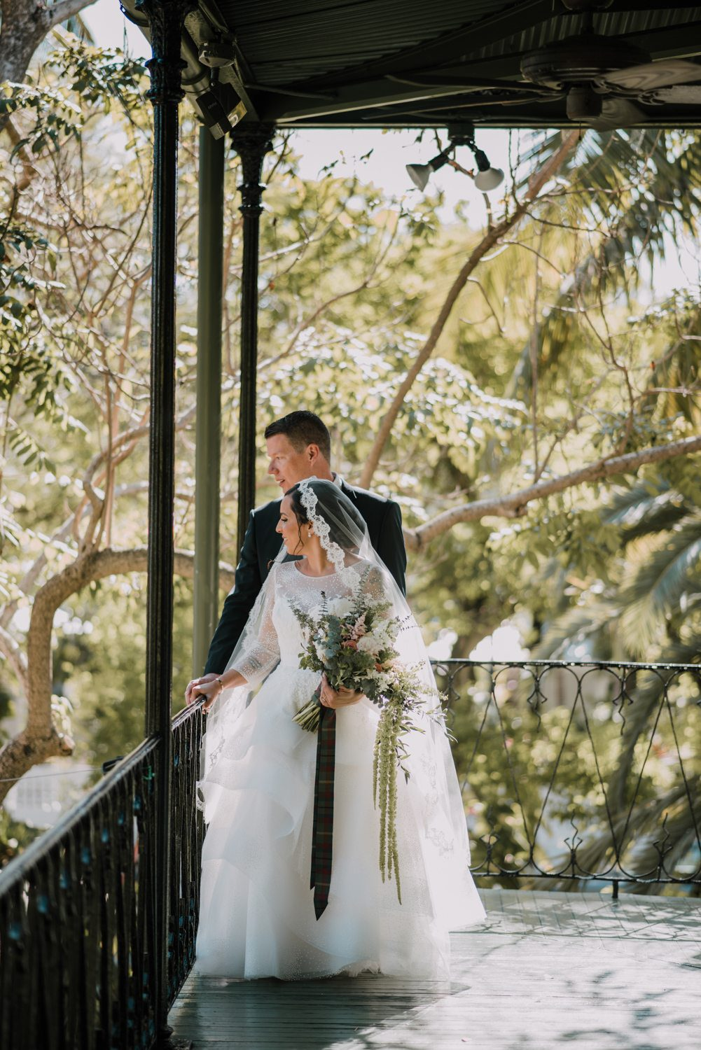 Bride and goom posing for pictures at hemingway house