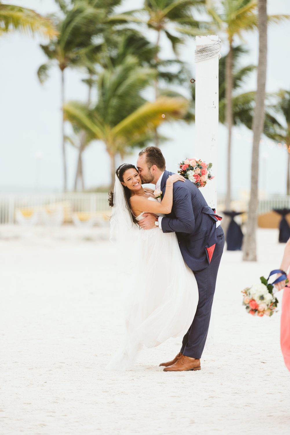 husband kissing wife after wedding ceremony at southernmost beach resort