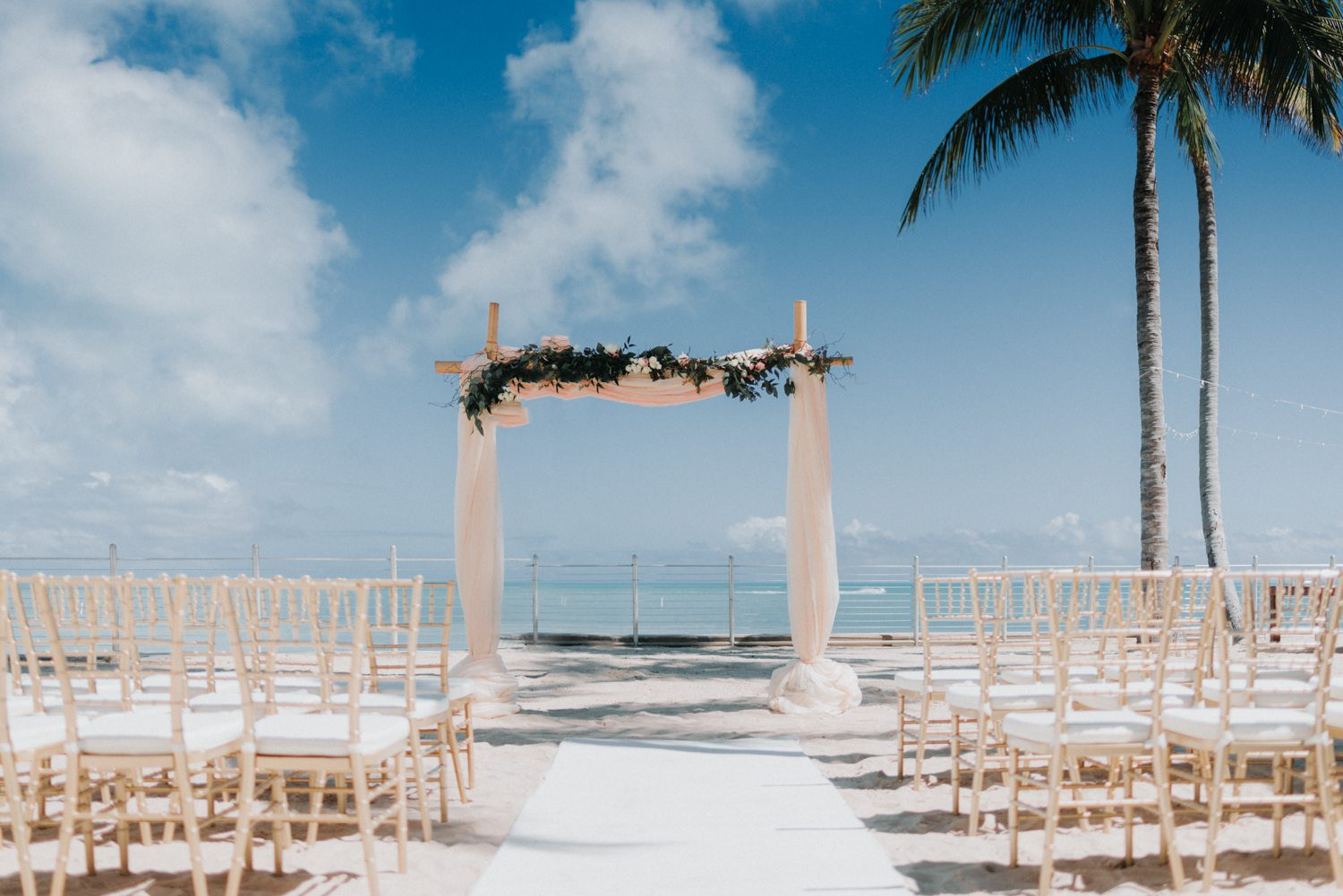 wedding stage and chairs set up at southernmost beach resort
