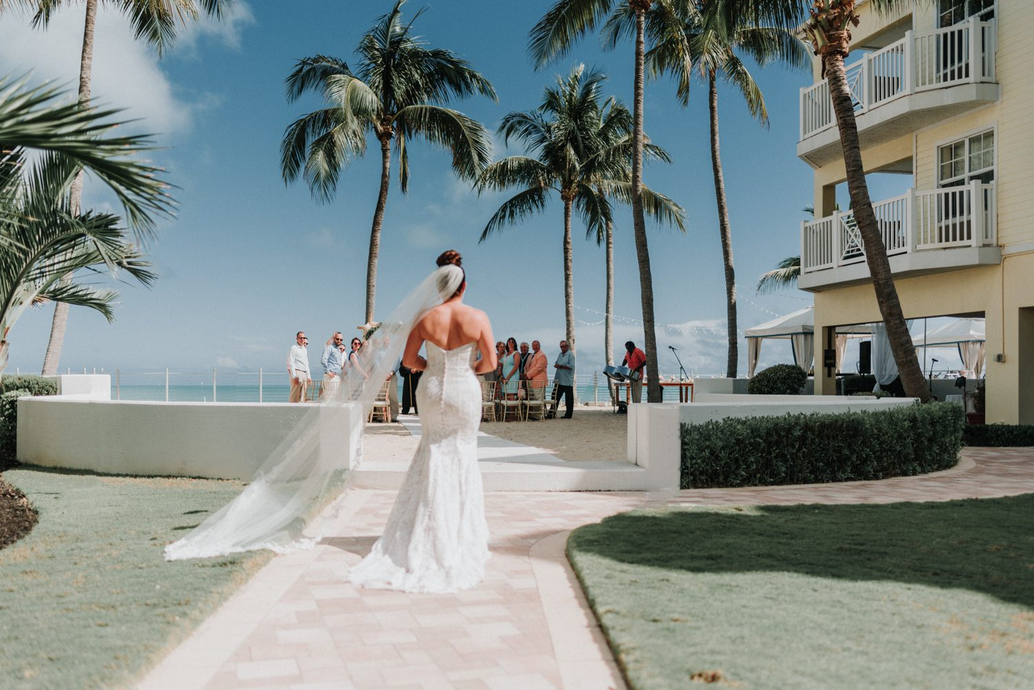 bride walking down the aisle for her wedding at southernmost beach resort