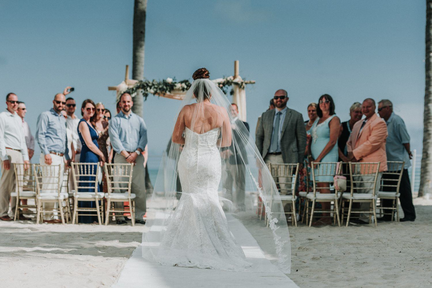 bride walking down the aisle for her beach wedding at southernmost beach resort