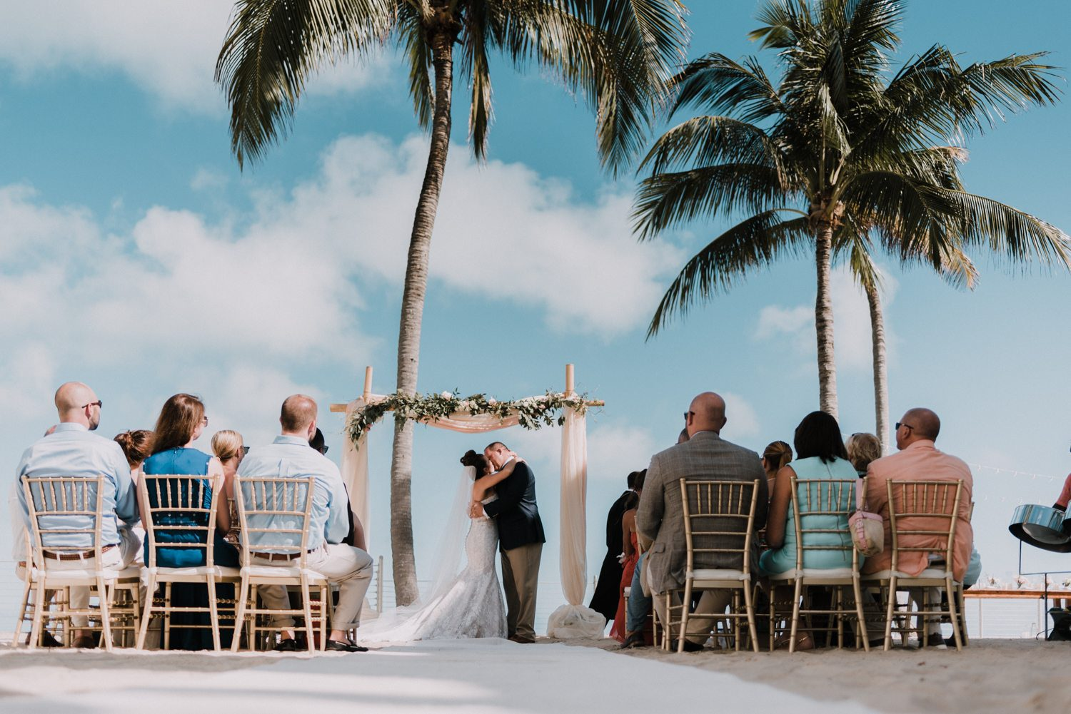 couple kissing after wedding vows at southernmost beach resort