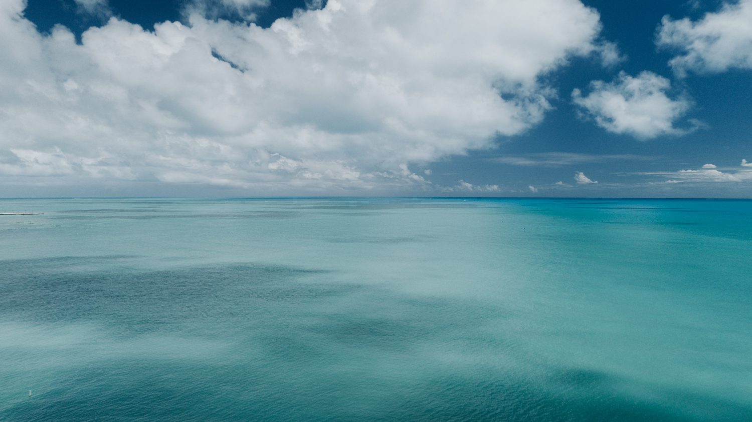 drone shot of the ocean at southernmost beach resort