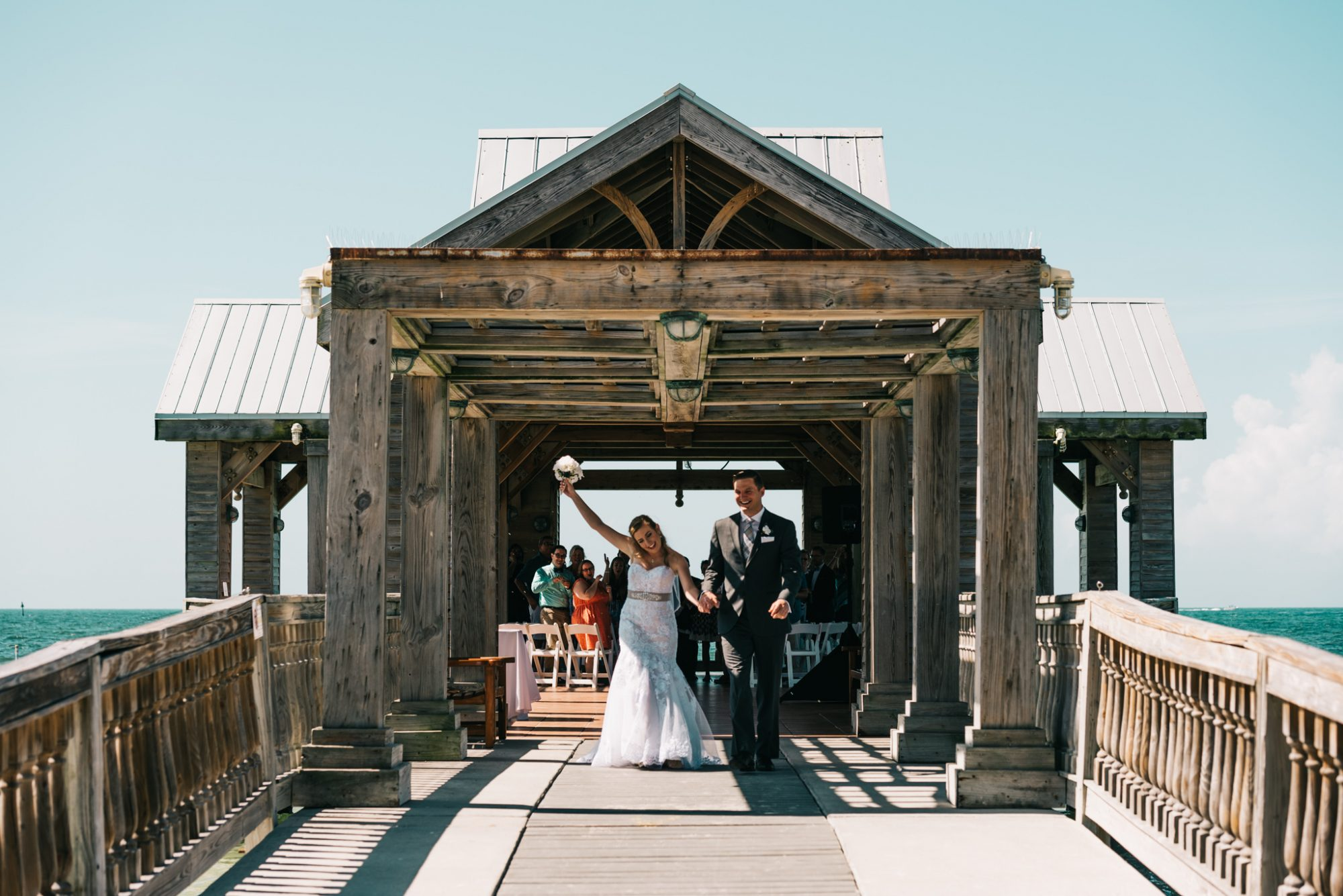bride and groom walking out of their wedding ceremony at southernmost beach resort