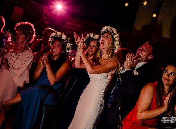 Bride dancing with bridesmaids in wedding reception