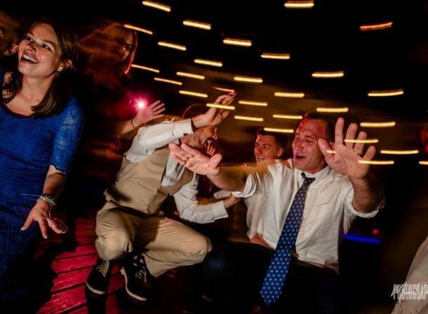 Groom dancing with his groomsmen