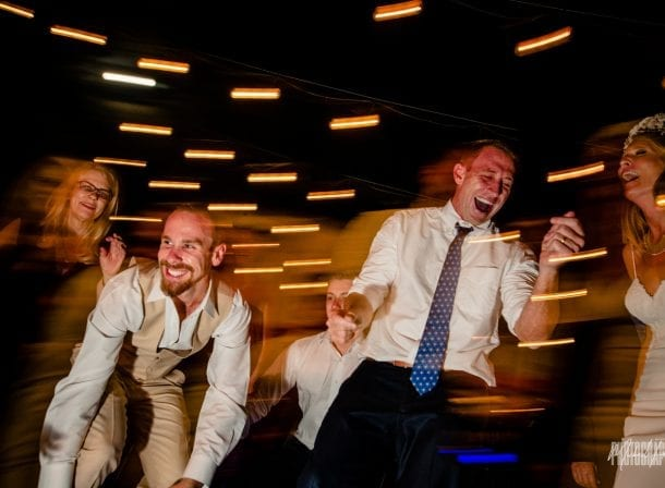 Groom dancing with his groomesmen