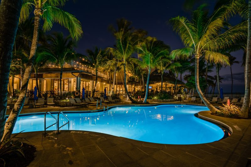 the pool at a hotel with lights at night