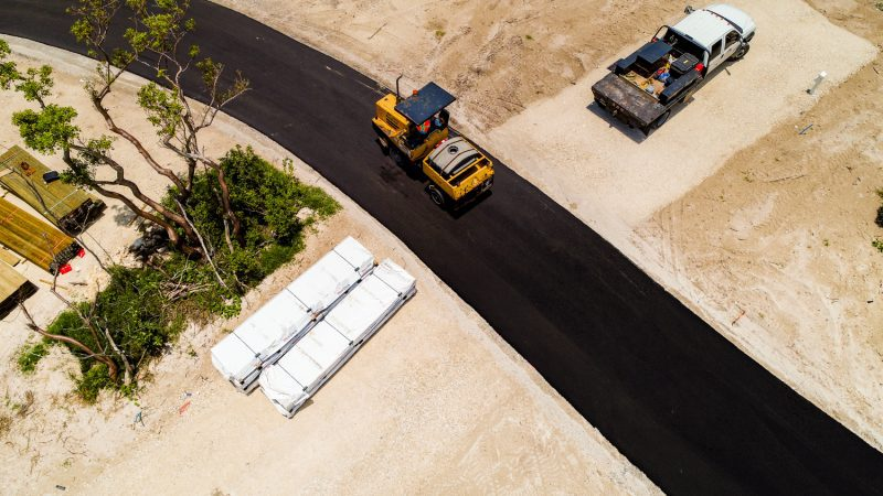 Commercial photography of a steam roller paving new a new road