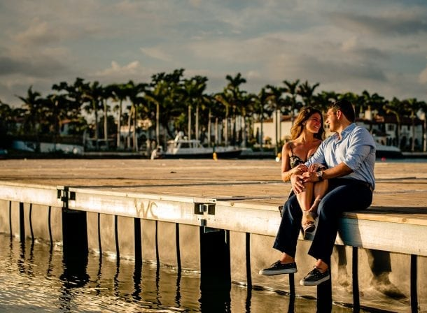 Couple sitting on a pier