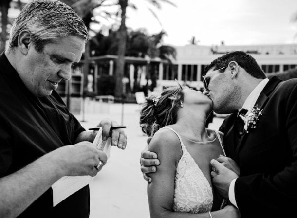 Bride and groom kissing after saying their vows