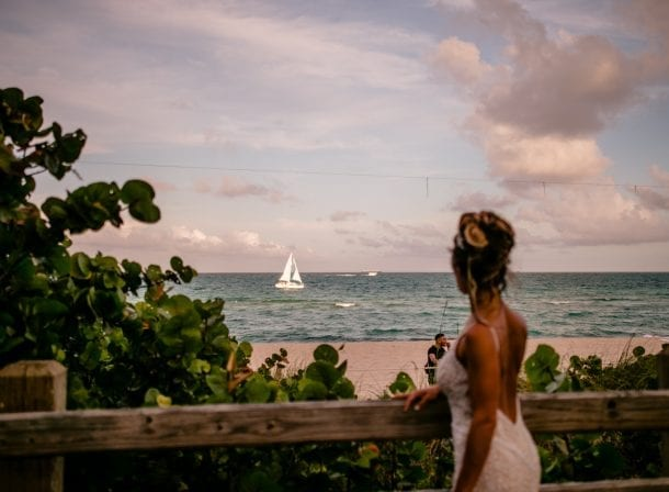 Bride looking at the ocean for their miami beach wedding