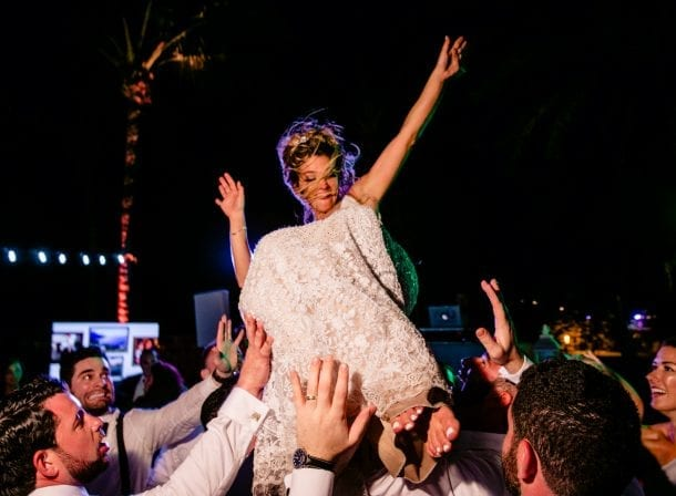 Bride being carried at her wedding reception