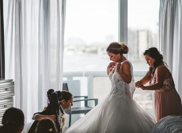 Bride putting on her wedding dress and shoes