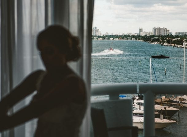 Beach in the background of a miami wedding