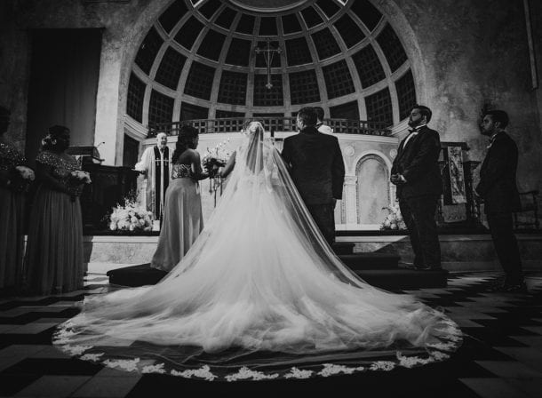 Bride's dress train flowing behind her