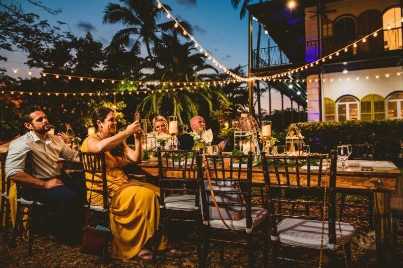 Bridesmaid clapping at wedding reception
