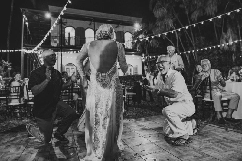 Bride and others dancing at a wedding reception